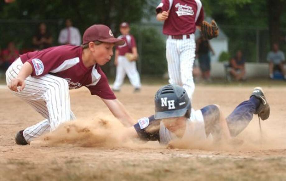 Photo/Alex von kleydorff. Cranbury''s # 6 Quinn Sandor tags a New Haven player out at first base to end the inning