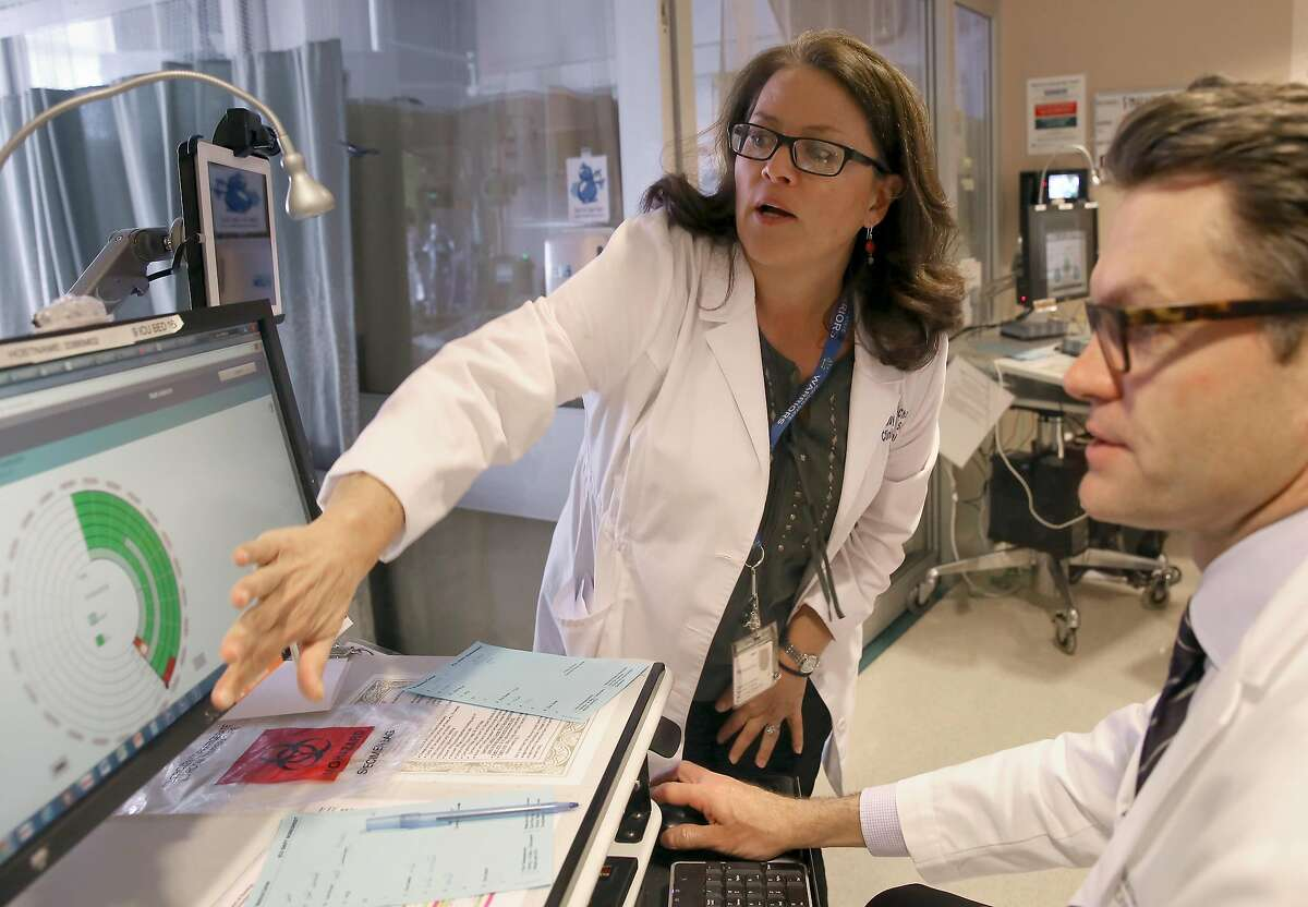 Clinical nurse specialist and project co-lead Hildy Schell-Chaple (middle) and Matthew Aldrich, MD (right) show how the software of Project Emerge is being used at an intensive care unit at UCSF hospital on Wednesday, June 15, 2016 in San Francisco, Calif.. UCSF and Johns Hopkins University School of Medicine are testing software they hope will improve intensive care.