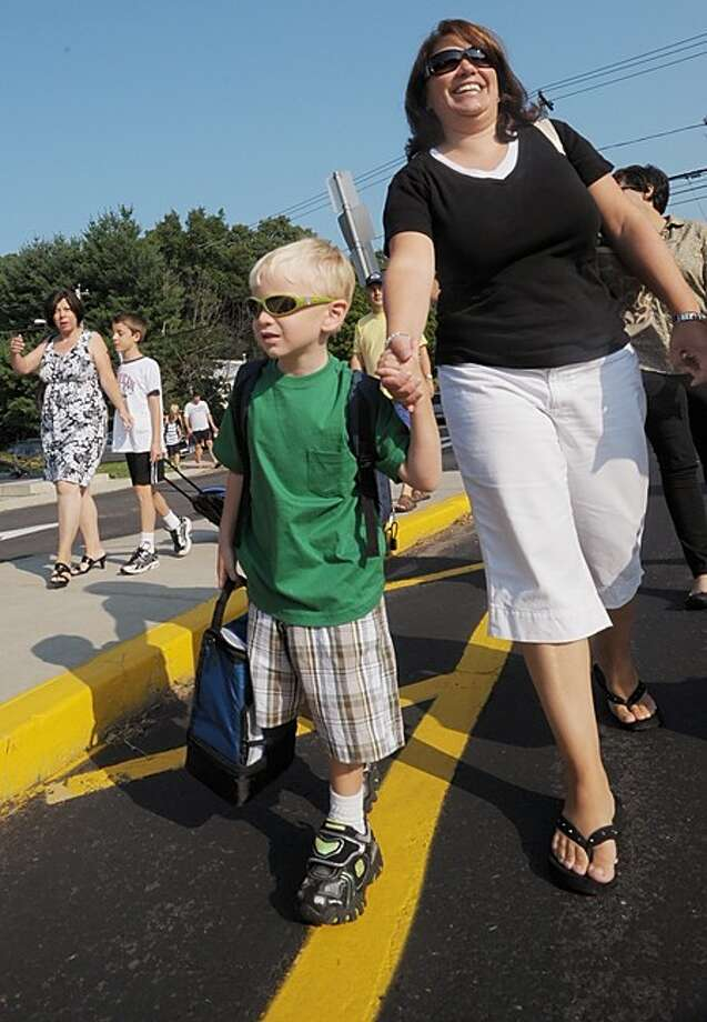 Sandra Ehlers takes her four year old son, Andrew, to Kendall Elementary School for his first day of kindergarten Wednesday. Hour photo / Erik Trautmann