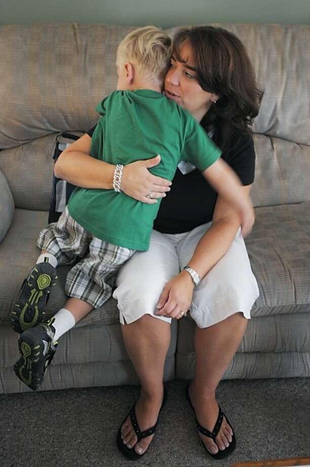 Sandra Elhers comforts her four year old son, Andrew, before his first day kindergarten Wednesday. Hour photo / Erik Trautmann