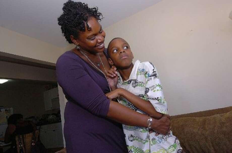 Photo/Alex von Kleydorff. Latisha Johnson and 8yr old son Christian, who suffers from severe autism.