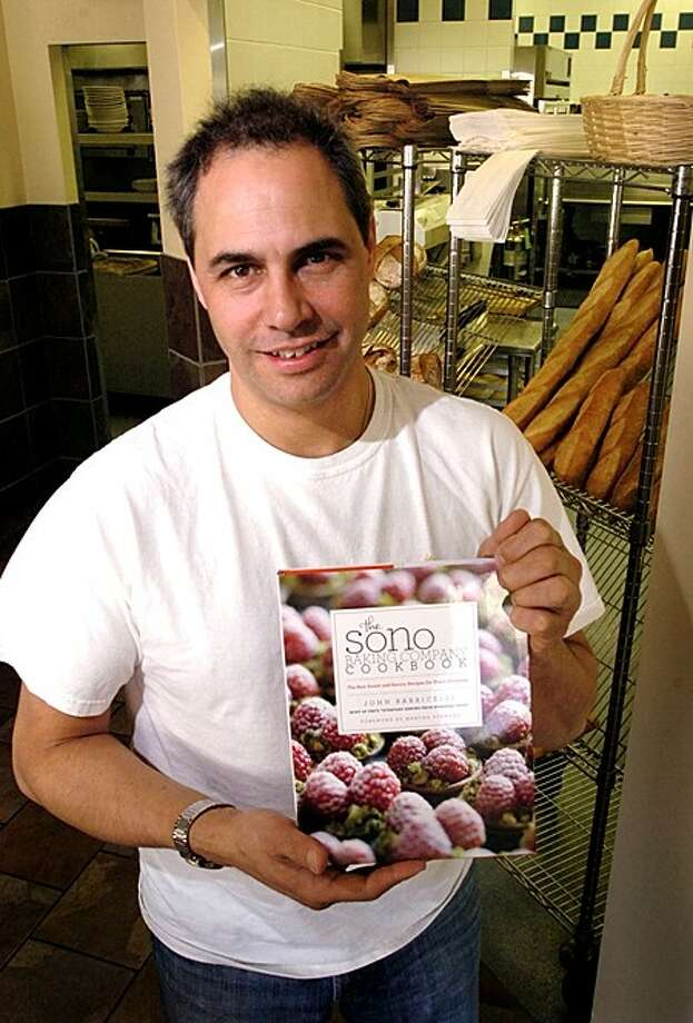 John Barricelli, owner of Sono Bakery with his new cookbook. Hour photo / Erik Trautmann