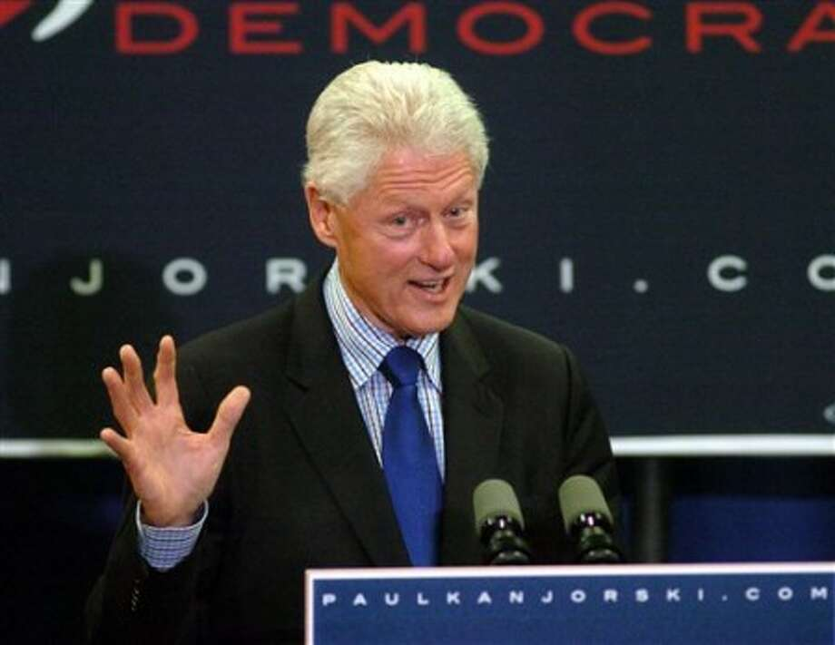 Former President Bill Clinton gestures at a campaign rally for U.S. Rep. Paul Kanjorski on Tuesday, Oct. 26, 2010, at Nanticoke Area High School, in Nanticoke, Pa. (AP Photo/The Citizens Voice, Mark Moran)