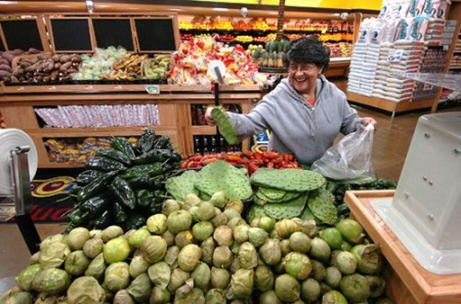 Photo/Alex von Kleydorff. Maria Lopez selects some Nopal in the produce section of Compare Foords in SONO.