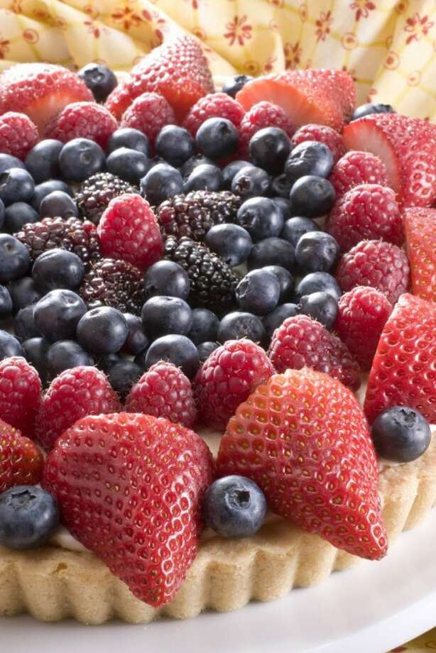An American berry tart is seen in this May 30, 2010 photo. A holiday as big as the Fourth of July deserves a big dessert with serious panache like this Independence Day worthy fresh summer berry tart. (AP Photo/Larry Crowe))
