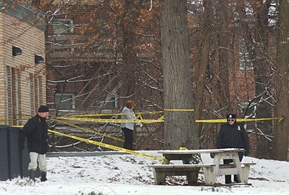 Norwalk police investigate the crime scene where a body was discovered next to Nathaniel Ely School Wednesday morning. Hour photo / Erik Trautmann