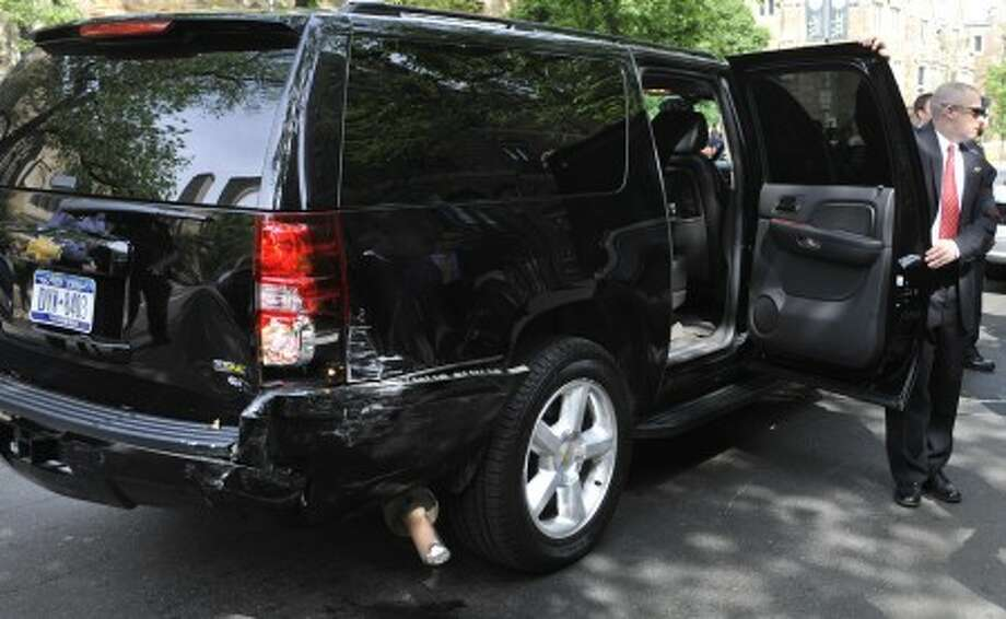 Damage is seen here on a vehicle carrying former President Bill Clinton in New Haven, Conn., Sunday, May 23, 2010. The vehicle carrying the former President was involved in an accident en route to Yale, no injuries were reported and he arrived on time to deliver the Yale Class Day address. (AP Photo/Jessica Hill)