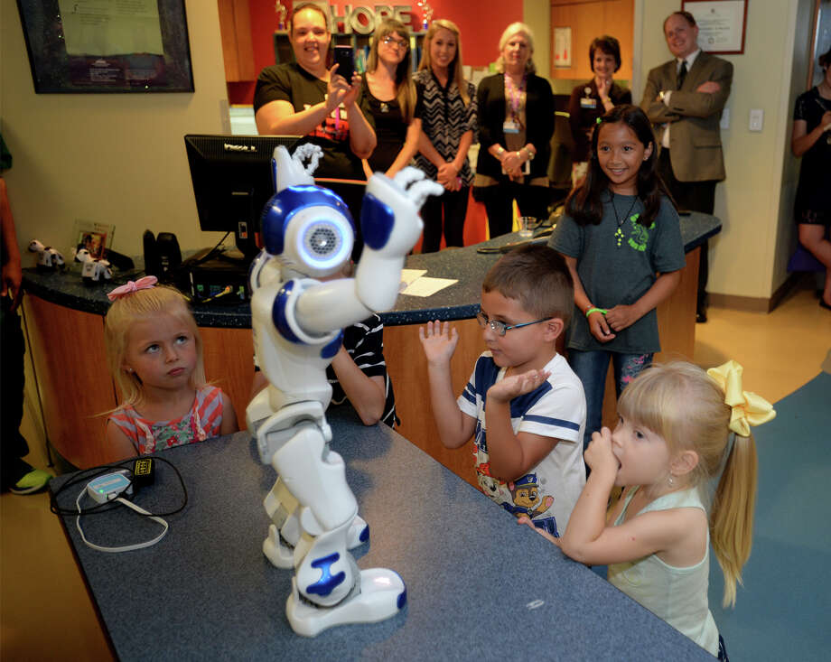 St. Elizabeth's newest piece of technology walks and talks through the pediatrics hallway during an unveiling on Thursday. Named C.H.A.M.P., the knee high robot is designed to distract children from the stress of being hospitalized.  Photo taken June 16, 2016 Guiseppe Barranco/The Enterprise Photo: Guiseppe Barranco, Photo Editor