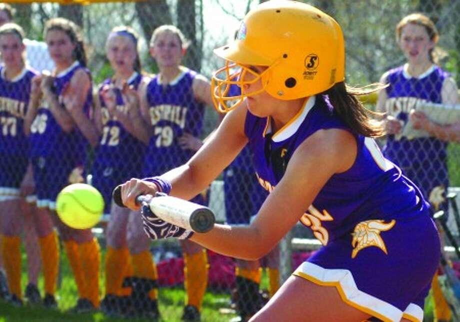 Westhill softball shortstop Julianne Vincent is about to lay down a bunt during a game against Trinity Catholic. Times photo/Matthew Vinci