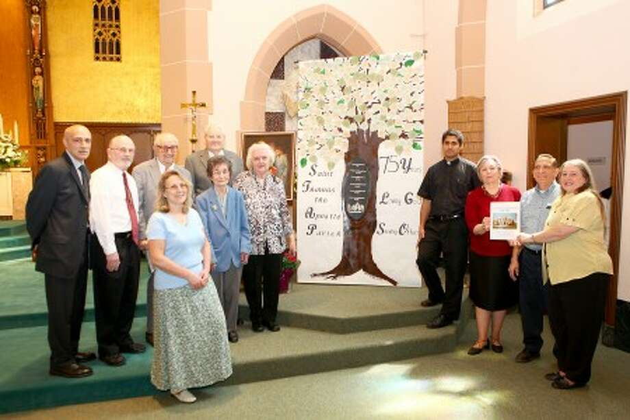 Vincent Irrera, Deacon Joe Gagne, A. William Harrik an usher of 80 years, Henry and Margaret Simon, Karen Gasper, Carm Pagliano, Father Sudhir D''Souza, Mary Ann Schmotzer, Lou Siladi and Alice Prunotto gather for a photo before a celebration mass honoring the 75 year anniversary of St. Thomas the Apostle Parish Sunday morning. DAVID ESPOSITO / Hour photo