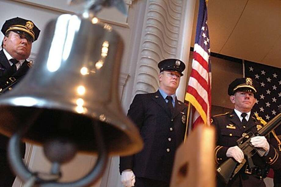 Norwalk Fire and Police Department Joint Honor Guard post the colors at the Norwalk City Hall Concert Hall Friday for the 9-11 Remembrance ceremony. hour photo/matthew vinci
