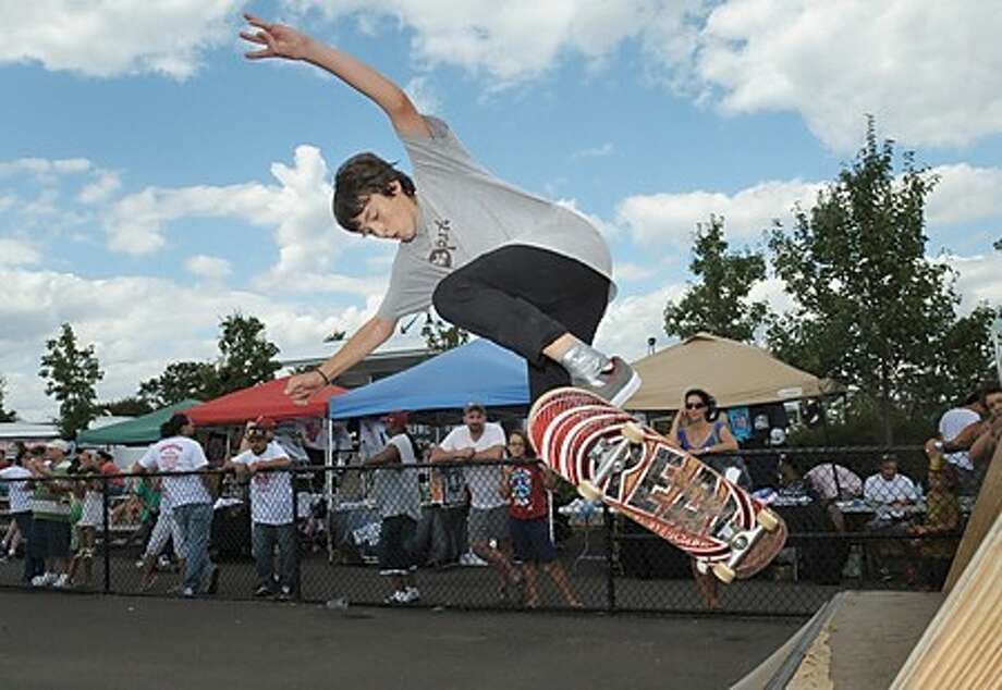 14 year old Luca Kupper gets ready for the ntermediate competition at The Throwdown @ The Beach skateboarding event at Calf Pasture Beach Saturday. Hour photo / Erik Trautmann