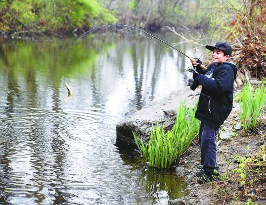 Opening Day for fishing brings families, enthusiasts to Norwalk River