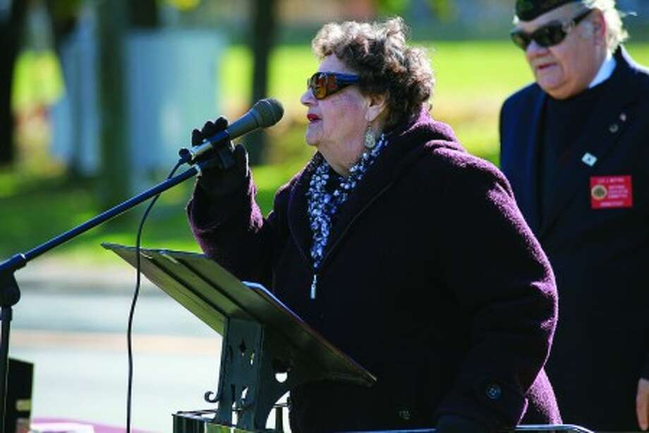 Helen Schoenberger speaks about her late husband Jules Wallerstein who was honored during the American Legion''s Veteran of the Month ceremony Sunday morning. Hour Photo / Danielle Robinson