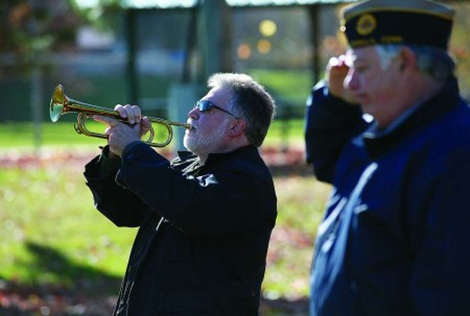 Reed Corbo plays taps in honor Jules Wallerstein who was remembered during the American Legion''s Veteran of the Month ceremony Sunday morning. Hour Photo / Danielle Robinson