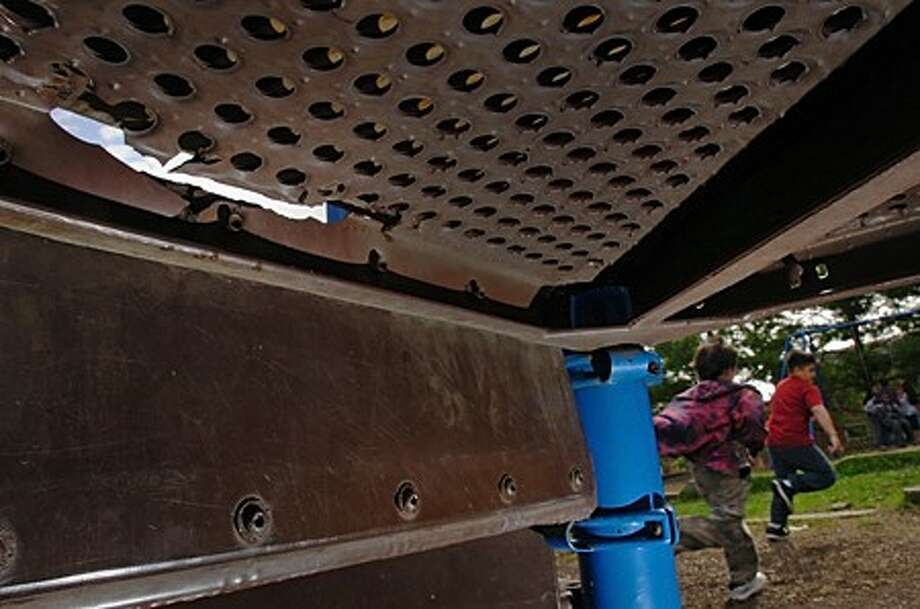 The playgound at Jefferson School where broken equipment and uneven surfaces pose hazards to children. Parents at Jefferson are upset at the fact that while other schools are recieving new playgrounds their school is not. Hour photo / Erik Trautmann
