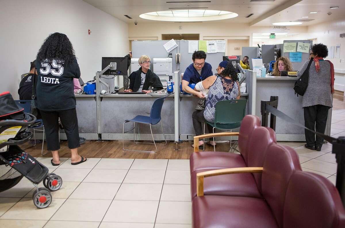 Patients check into the emergency department at Highland Hospital in Oakland in 2016.