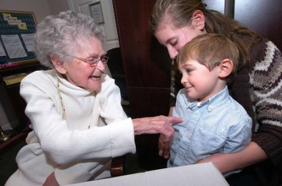 Photo/Alex von Kleydorff. 100yr old Anna Dohan-Westhelle gives a tickle to her 3yr old Great Grandson Ross Dildine as 13 yr old Great Grandaughter Elizabeth Arenare gives him a hug during a birthday party to mark her century milestone.