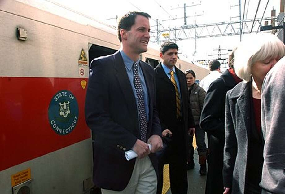U.S. Representative Jim Himes exits a Metro-North train on the Danbury branch rail line at South Norwalk while on a tour to promote commuter rail in western Connecticut. Hour photo / Erik Trautmann
