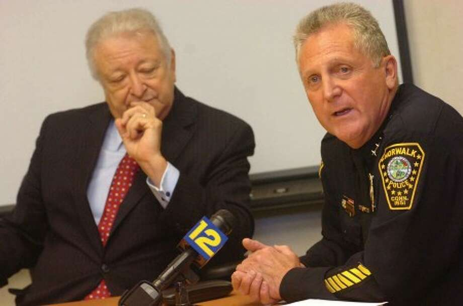 Hour photo / matthew vinci Mayor Richard A. Moccia and Police Chief Harry W. Rilling speak to the media during a news conference Monday about recent firearms arrests and a shooting incident Sunday night on South Main Street.