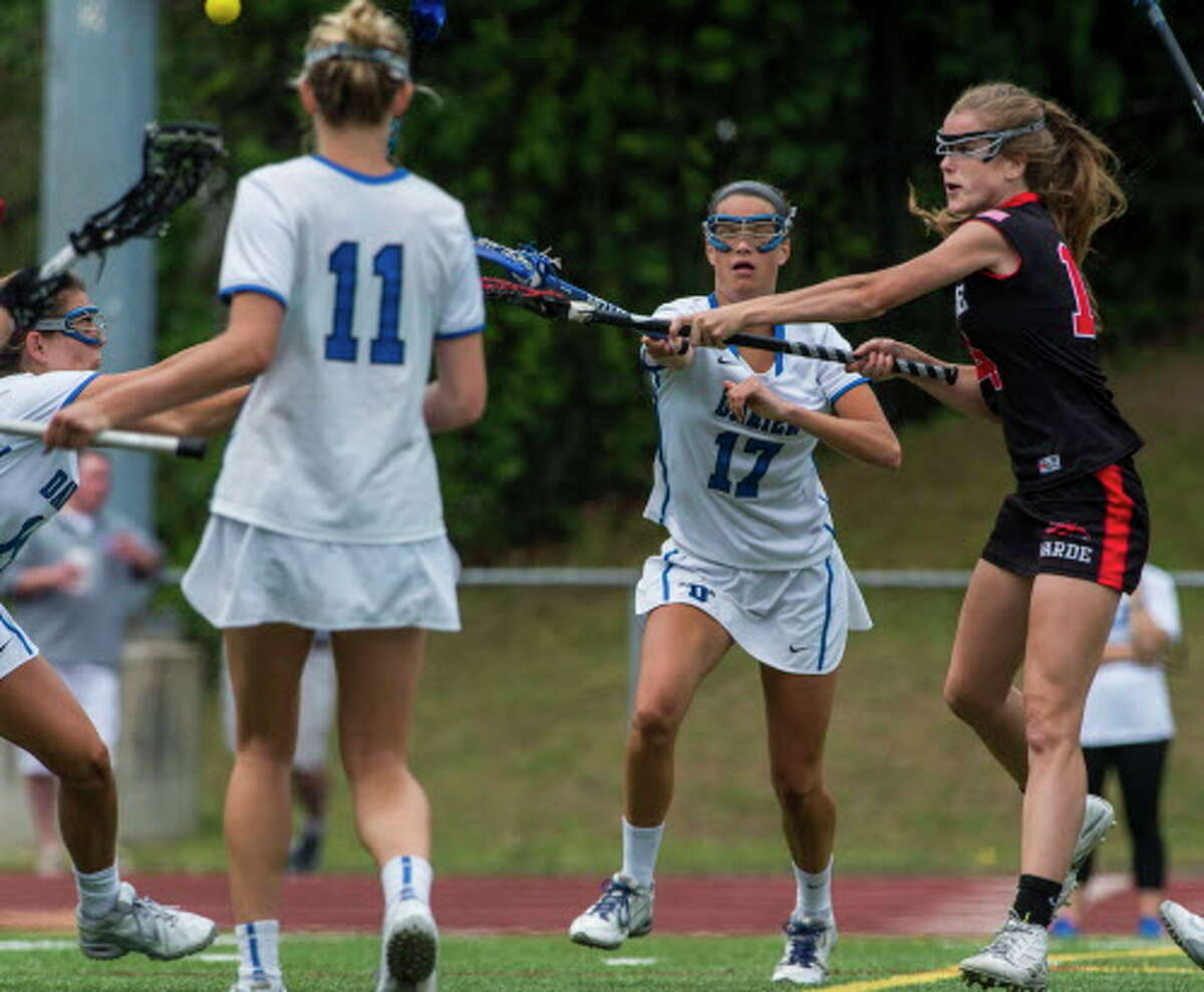 Warde's Libby McKenna fires a shot through the Darien defense during action in the Class L girls' lacrosse championship on June 11. McKenna scored four goals but the Mustangs lost a 12-5 decision.