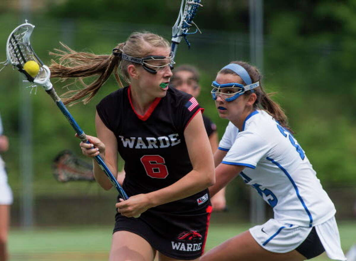 Warde's Hannah Dougherty controls the ball during the Class L girls lacrosse championship against Darien. The Mustangs dropped a 12-5 decision to the Blue Wave.