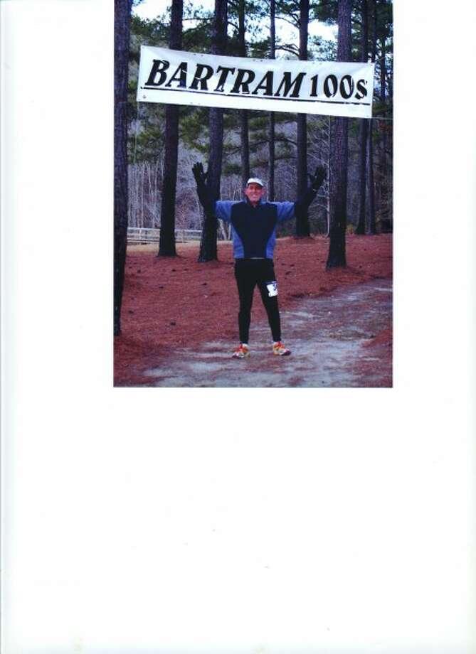 THE RUNNING MAN In his 100th marathon, city man runs 100 miles