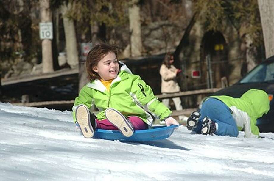 Sabina Cak 4, rides the hill Sunday at the Let Snow Weekends event held at the Stamford Museum and Nature Center. hour photo/matthew vinci
