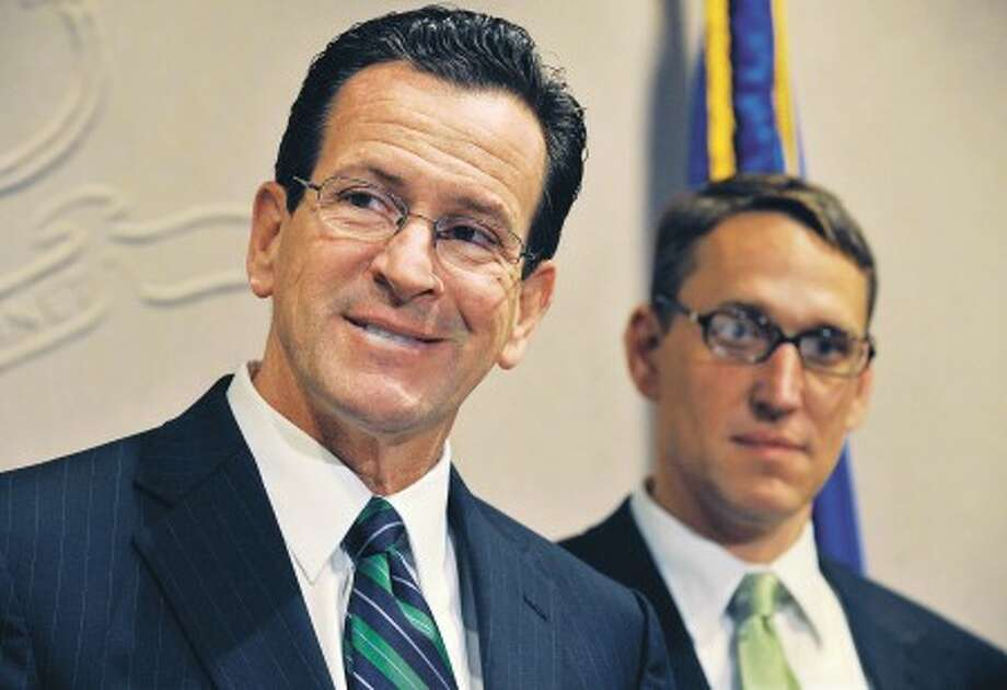 Connecticut Gov.-elect Dan Malloy, left, smiles after announcing Benjamin Barnes, right, as his choice for secretary of the Office of Policy and Management, one of the most important positions in his cabinet, at a news conference at the Legislative Office Building in Hartford, Conn., Wednesday, Nov. 17, 2010. (AP Photo/Jessica Hill)