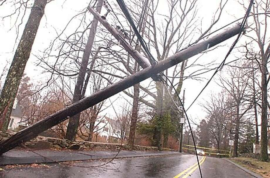 A telephone pole down on King and William streets in Norwalk closing the road Sunday morning. hour photo/matthew vinci