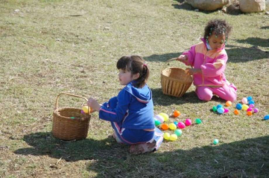 Children hunt for eggs at last year''s Hecksher Farm annual egg hunt. (contributed photo)