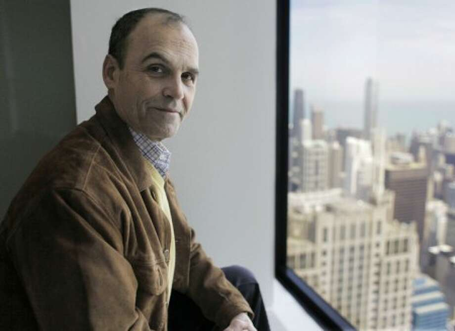 """In this photo taken March 31, 2010, Chicago attorney and author Scott Turow, poses in a conference room at his law firm in Chicago. Turow''s new book """"Innocent,"""" a sequel to his blockbuster book turned Hollywood movie """"Presumed Innocent,"""" will be released Tuesday, May 4, 2010. The new book revisits characters Rusty Sabich and Tommy Molto, pitting the pair against each another once again. (AP Photo/M. Spencer Green)"""