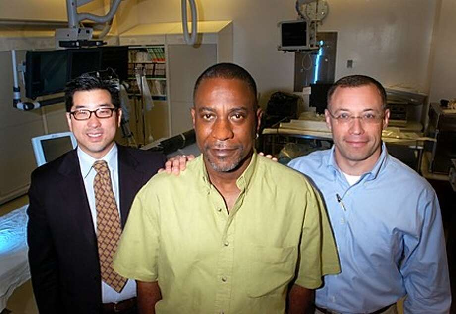 Angioplasty patient Curtis Tinnin, center, and Dr. Joonun (Chris) Choi and Dr. Ted Portnay of Stamford Hospital. Hour photo / Erik Trautmann