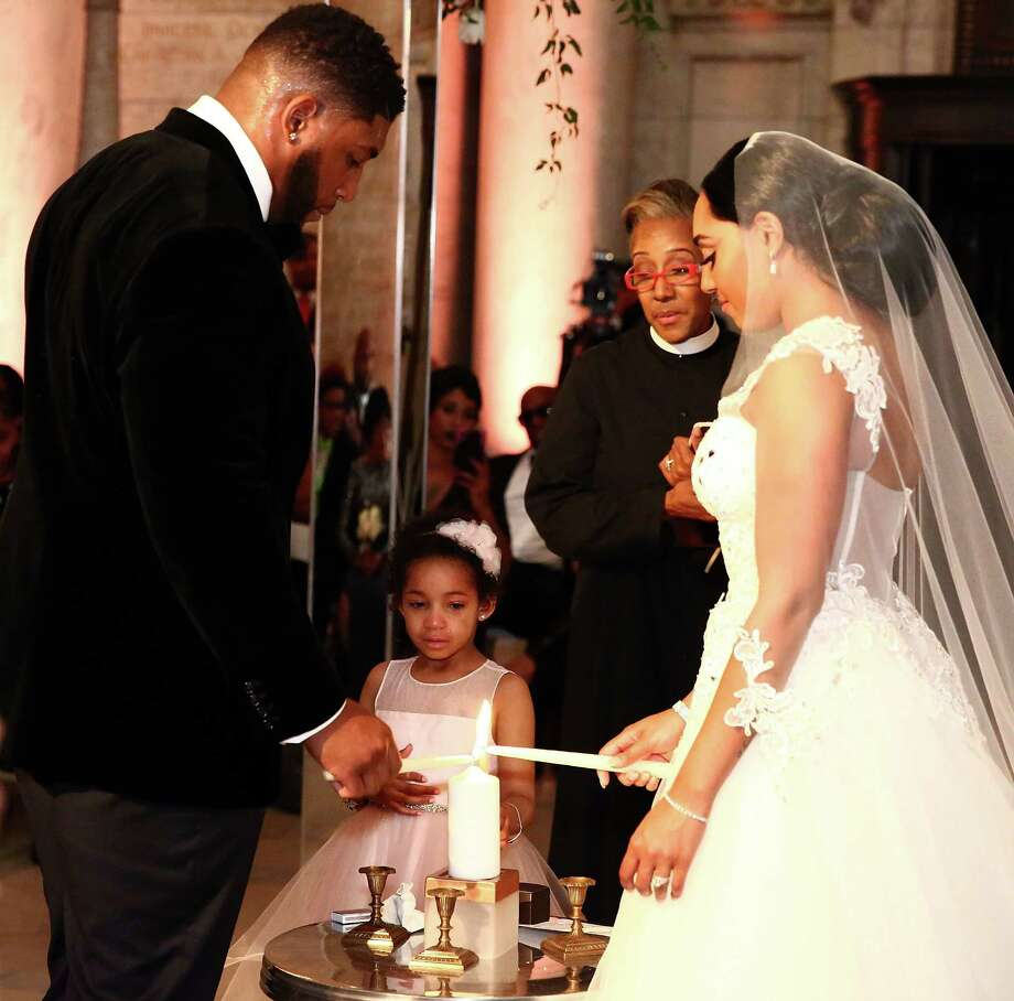 NEW YORK, NY - MAY 13:  (L-R) NFL Player Devon Still, daughter Leah Still and Asha Joyce light candles during The Knot Dream Wedding  on May 13, 2016 in New York, New York.  (Photo by Astrid Stawiarz/Getty Images) Photo: Astrid Stawiarz, Stringer / 2016 Getty Images