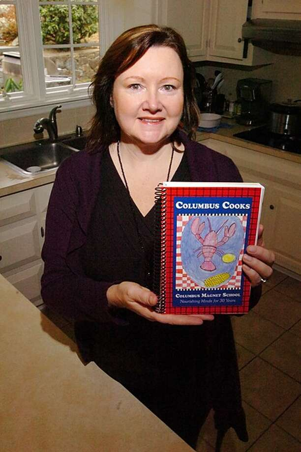 Columbus Magnet School parent Tara Forschino spearheaded the publishing of the Columbus Cookbook as a fundraising effort for the school. Hour photo / Erik Trautmann