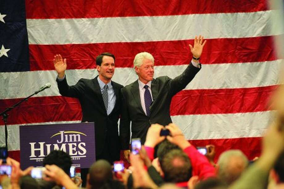Jim Himes and Bill Clinton speak during a rally at Sono Fieldhouse in Norwalk Sunday evening. Hour Photo / Danielle Robinson