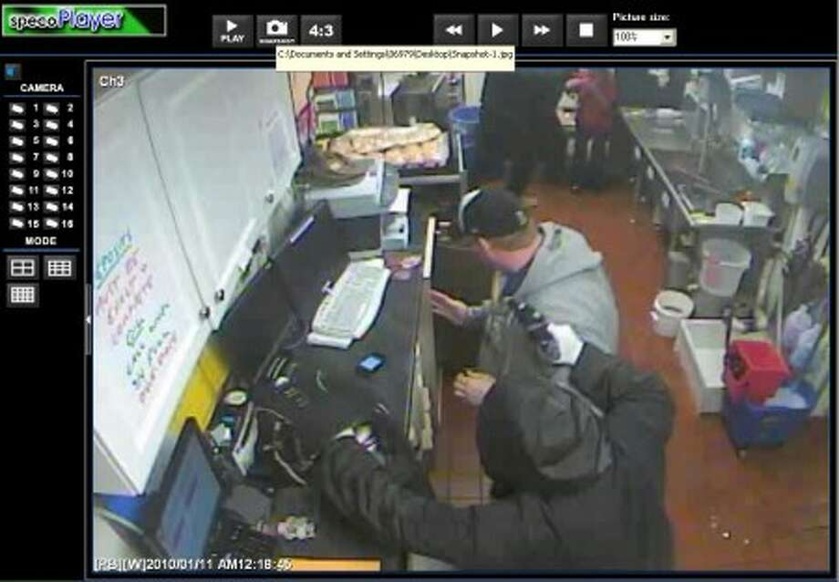 Police are searching for two suspects who allegedly robbed a Westport McDonald''s at gun and knife point shortly after midnight on Monday, a department spokesperson said.