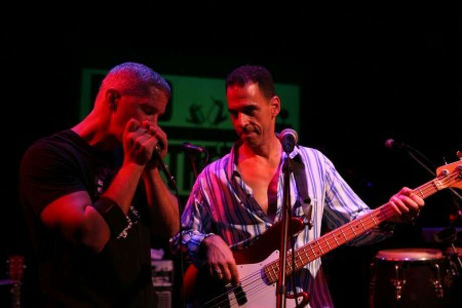 Rob Fried and Jerry Vigorito, founders of Band Together, jam at a previous concert. The organization is having a concert for Haiti this weekend in Fairfield.