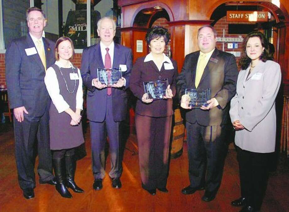 Greater Norwalk Chamber of Commerce president Ed Musante, NEF event co-chair Robin Guareiri, NEF Corporate Partner in Education Award recipient and Xerox Foundation President Joseph Cahalan, NEF Individual Partner in Education Award recipient Irene Dixon, Tony Aitoro, co-owner of Aitoro Appliance and NEF Small Business Partner in Education Award recipient and NEF Executive Director Lauren Rosato attend the Foundation''s 8th Annual Business Partners in Education Awards Breakfast at the Brewhouse restaurant Wednesday. Hour photo / Erik Trautmann