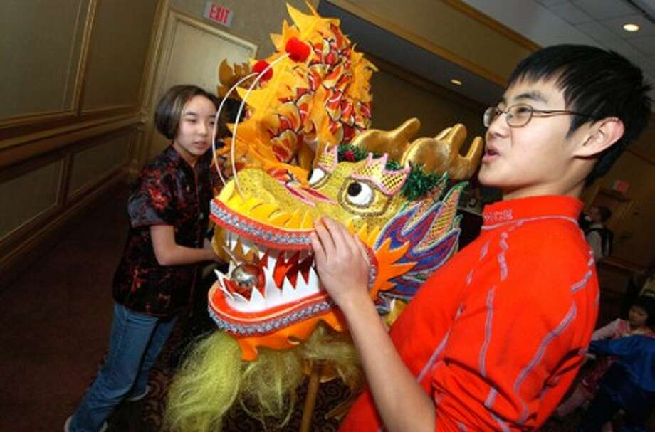 Photo/Alex von Kleydorff. 13 yr old Grant Wang and 14 yr old Emily Serven along with others prepare for the Chinese Dragon dance during Chinese New Year celebration.