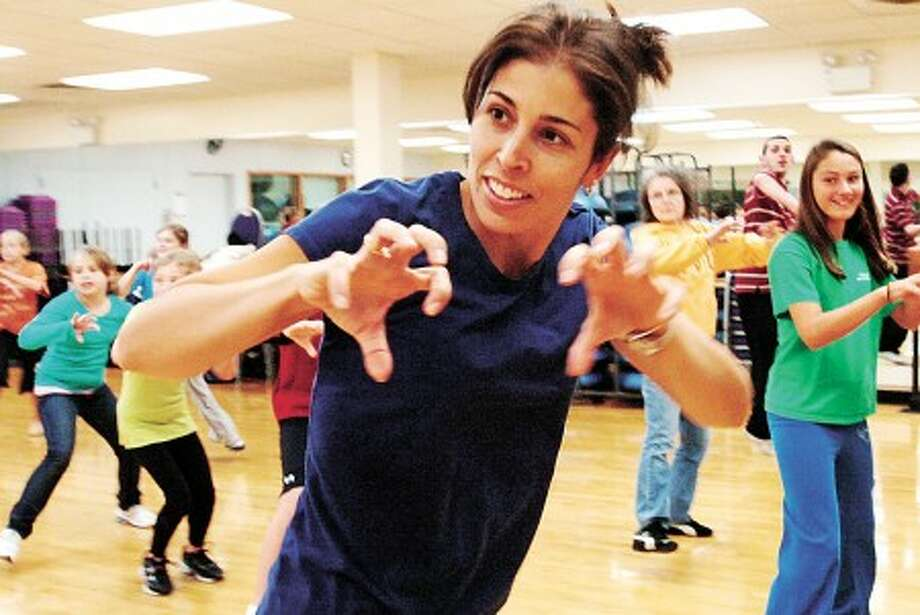 Carmen Rodriguez practices Michael Jackson''s Thriller at the Wilton YMCA Saturday. The Wilton Library and the Wilton Family Y are putting on a a worldwide simultaneous dance event on Saturday, October 23 to break a world record for most people dancing to Michael Jackson