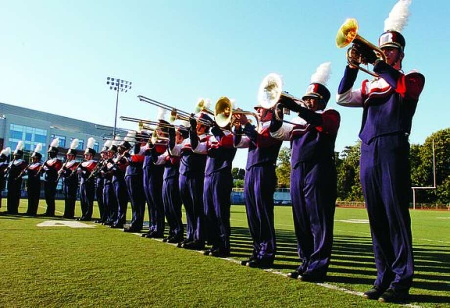 The Brien McMahon High School marching band takes the field to play the national anthem before the 21st annual Celebration of Sound Band Competition Saturday at the school. Hour photo / Erik Trautmann