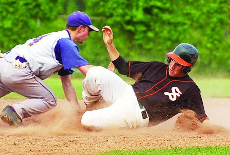 Stamford baseball player Steve Hagedus steals second base ahead of the tag of Scott Valenzano of Westhill during their game last Friday at Westhill High. Times photo/Erik Trautmann
