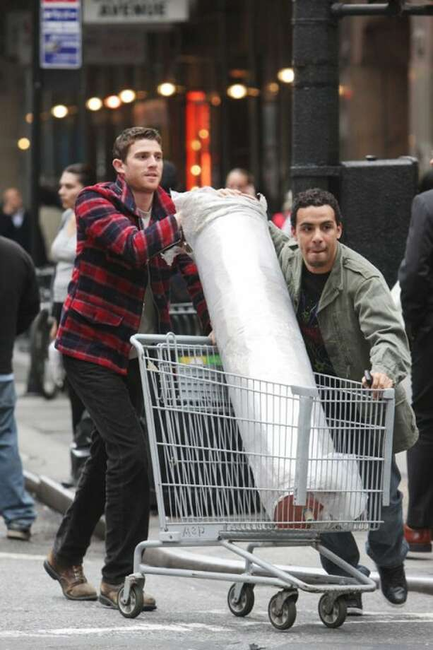 "In this image released by HBO, Bryan Greenberg, left, and Victor Rasuk are shown in a scene from the HBO original series, ""How to Make it in America."" (AP Photo/HBO, Eric Liebowitz)"