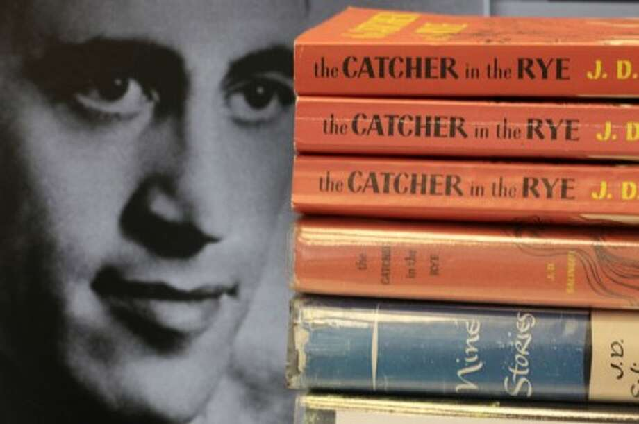"Copies of J.D. Salinger''s classic novel ""The Catcher in the Rye"" as well as his volume of short stories called ""Nine Stories"" are seen at the Orange Public Library in Orange Village, Ohio on Thursday, Jan. 28, 2010. Salinger, the legendary author, youth hero and fugitive from fame whose ""The Catcher in the Rye"" shocked and inspired a world he increasingly shunned, died Wednesday at the age of 91. At left is a 1951 photo of the author. (AP Photo/Amy Sancetta)"