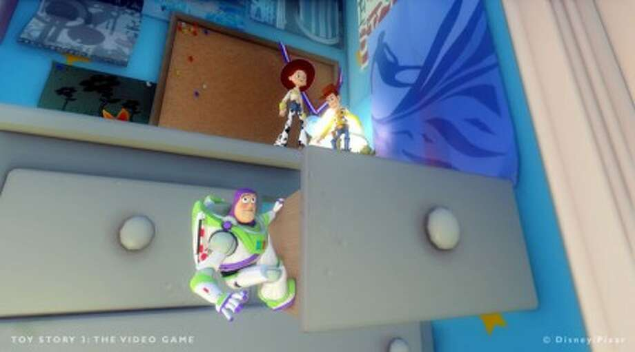 """In this video game image released by Disney Interactive, from left, characters Buzz, Jessie and Woody explore Andy''s bedroom in a scene from """"Toy Story 3."""" (AP Photo/Disney Interactive)"""