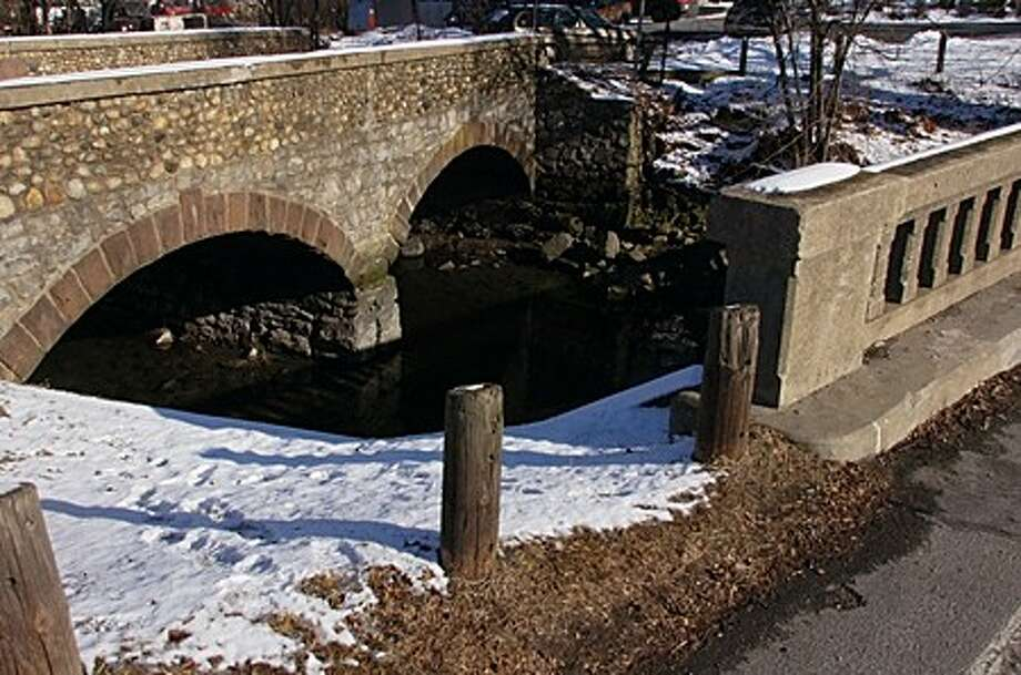 The Norwalk Department of Public Works is seeking $340,000 in the 2010-11 capital budget and help from Darien to tear down the Old Tokeneke Bridge on Route 136 at the Rowayton-Darien town line. The public works director says the bridge is in danger of collapsing. Hour photo / Erik Trautmann