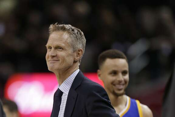 Golden State Warriors head coach Steve Kerr, left, and Stephen Curry smile after Curry fouled out of the game against the Cleveland Cavaliers during the second half of Game 6 of basketball's NBA Finals in Cleveland, Thursday, June 16, 2016. Cleveland won 115-101. (AP Photo/Tony Dejak)