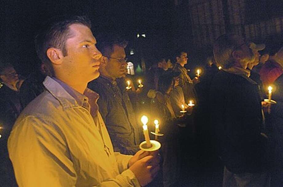 Brian Jacobs and Brian Rice among the people who attended the National Anti- Bullying Day at the Norwalk City Hall front lawn to remember the nine young men who killed themselves as a result of anti- gay bullying. hour photo/matthew vinci