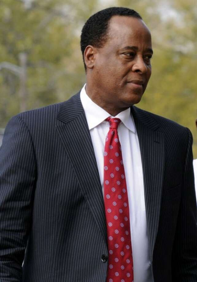 FILE - In this Nov. 23, 2009 file picture, Dr. Conrad Murray arrives at his clinic in Houston. Michael Jackson''s physician has arrived in Los Angeles in anticipation of a decision from the district attorney''s office on whether to charge him for the singer''s death, a spokeswoman said Tuesday Feb. 2, 2010. (AP Photo/Pat Sullivan, File)